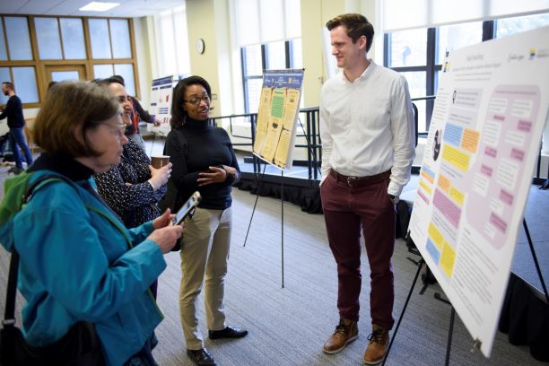 Joseph Muller presenting a poster at the University of Michigan Library